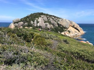 Inaccessible granite island at end of Tongue Point