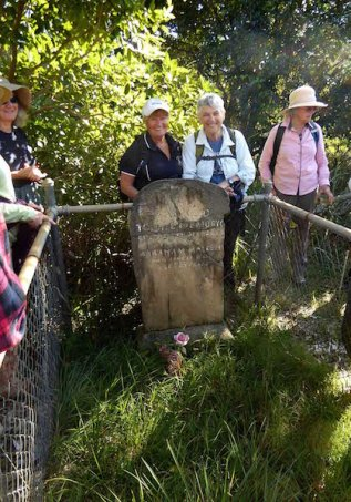 Batemans Bay bushwalkers Aliza Emery and Bev Brazel visit Elizabeth Maleber's grave on Broulee Island in 2017