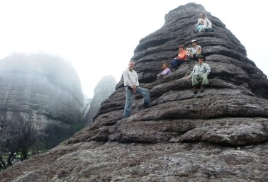 Pausing on the smallest of the seven pinnacles