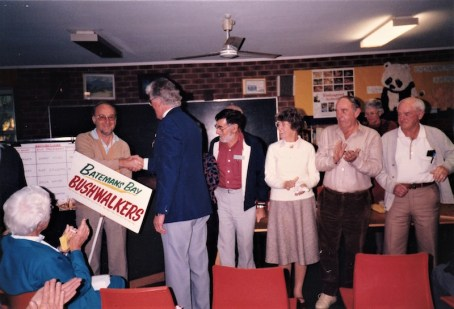 1987 Committee - outgoing inaugural President Geoff hands over the reins to Grant and the new Committee. Grant is holding sign.