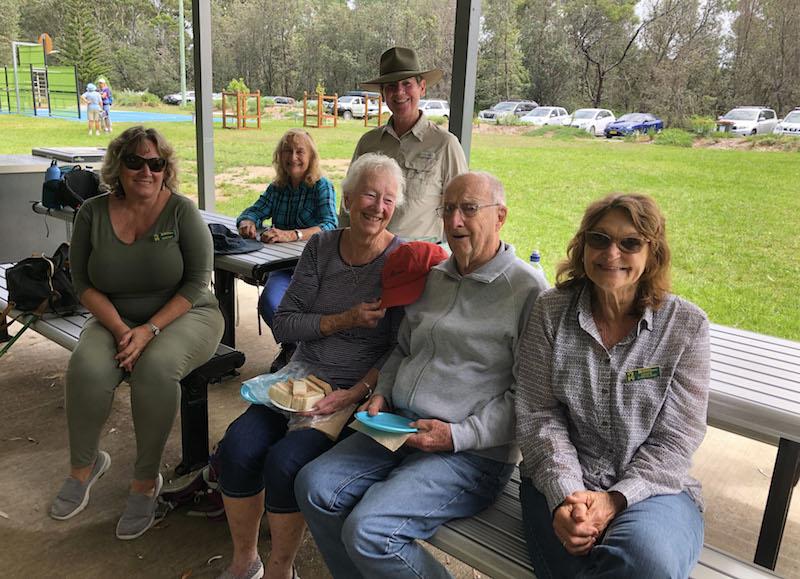 Deborah, Carol, Kaye, Meriel, Grant and Denise congratulating Grant on becoming a Centenarian