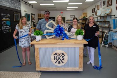 Hammer And Stain grand opening with a ribbon cutting