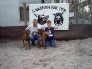 Nathan -- with his dog Ivan and a FIRST place trophy in the puppy bay -- Dad -- Greg -- took second place with Garnet
