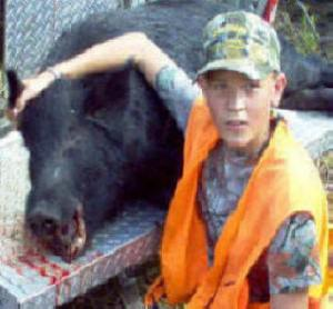 Bombing range -- Nathan's1st hog taken with a knife