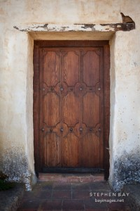 Photo: Heavy wooden door. Carmel Mission, California.