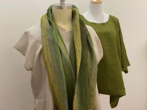 plus size ethical fashion and sustainable fashion - image depicts two plus size linen garments and a scarf all in natural and green shades