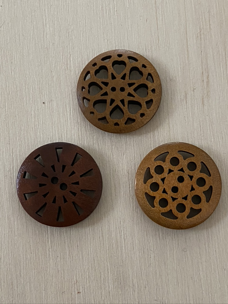 comparison of 25mm wooden buttons with cut-out designs