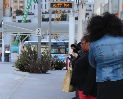 Commuters in San Francisco Transbay Terminal wait for bus after a day of work. (Photo by Mariana Raschke/Bay News Rising)