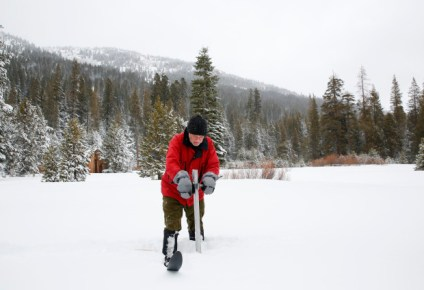 Frank Gehrke, chief of the California Cooperative Snow Surveys Program for the Department of Water Resources, plunges the survey tube into the snowpack as he conducts the first snow survey of the season at Phillips Station Tuesday, Jan. 3, 2017, near Echo Summit, Calif. The survey showed the snowpack at 53 percent of normal for this site at this time of year.  (AP Photo/Rich Pedroncelli)