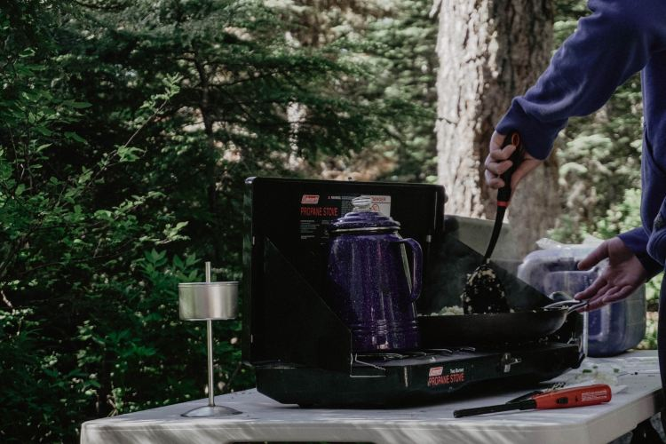 Cooking gluten free food from the menu over a camping stove