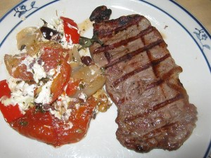 photo of plate with steak and gratin on the side