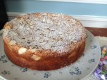 photo of finished cake dusted with confectioner's sugar