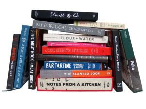 photo from Eater of cookbooks piled together and stacked