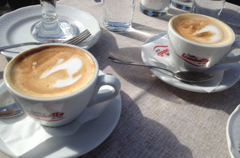 two cups of cappuccini