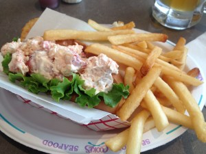 Plate of lobster roll with French fries