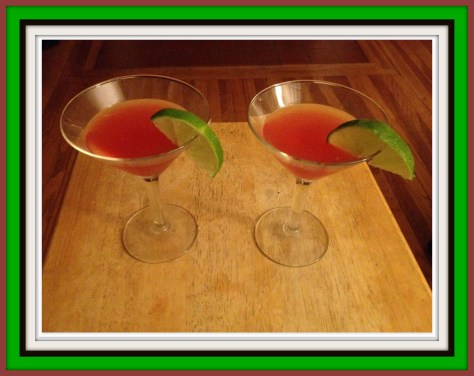 two Irish Rose cocktails garnished with slices of lime