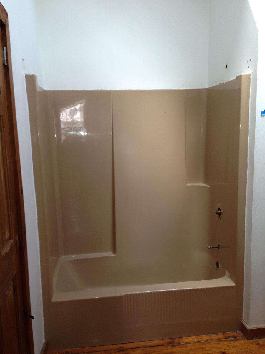 Combo fiberglass tub and shower unit prior to refinishing