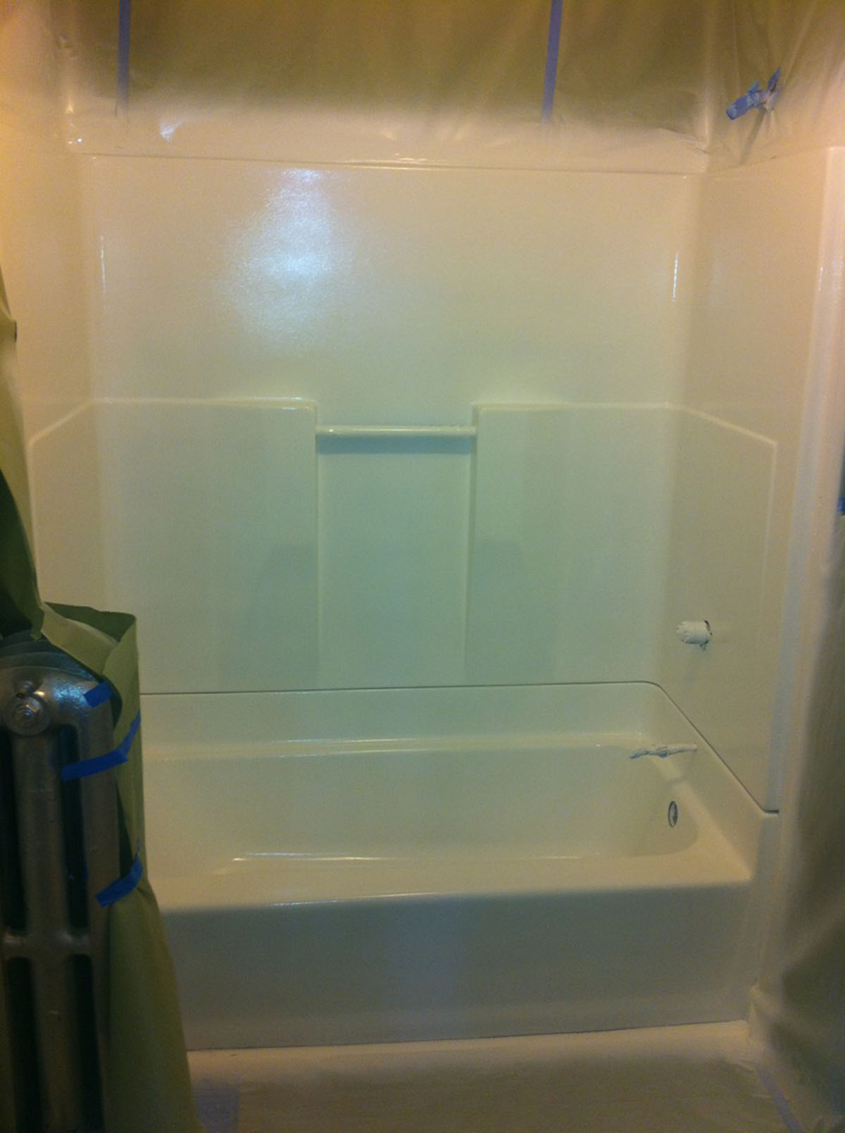Refinished fiberglass tub and shower surround after refinishing