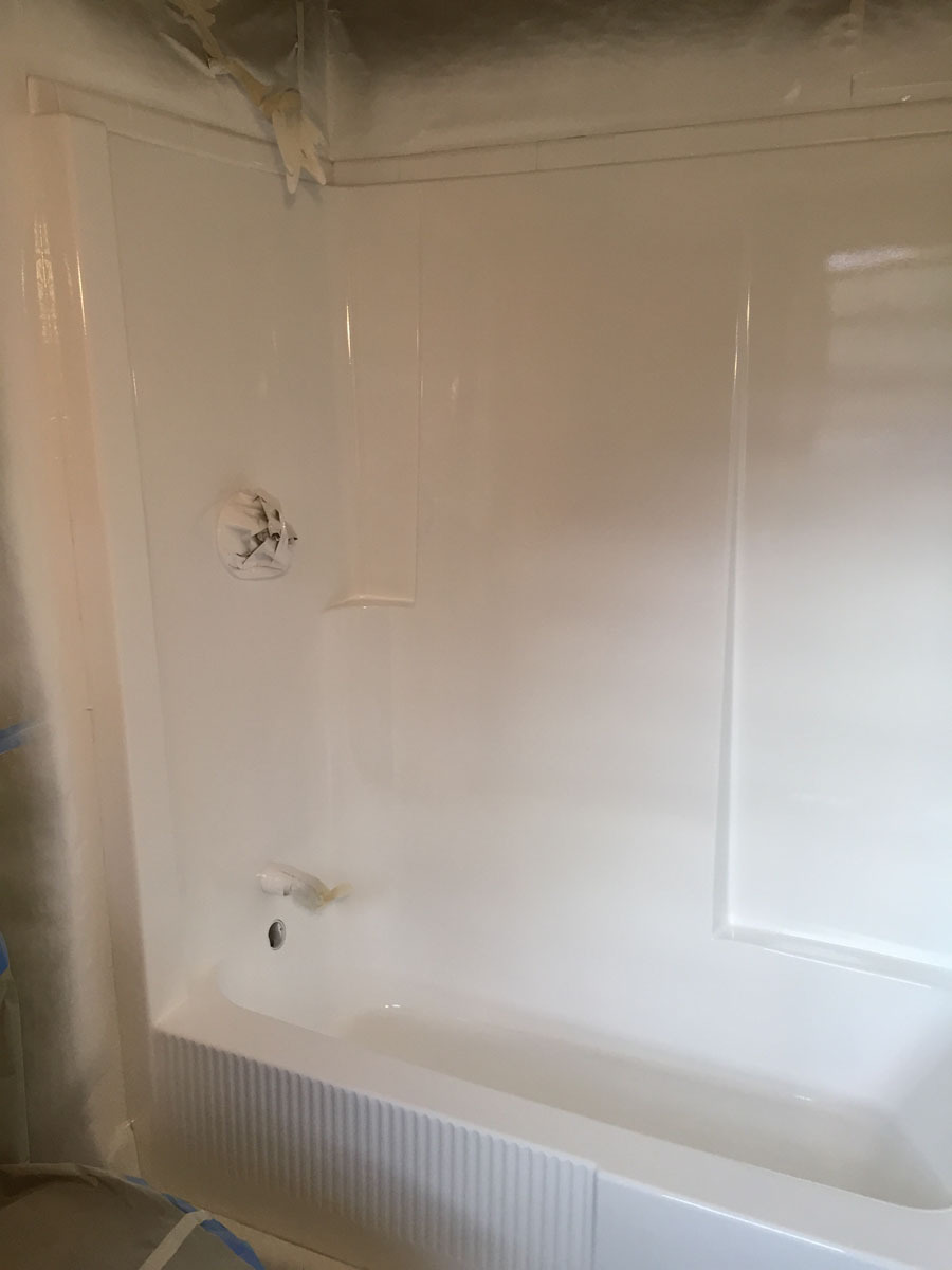 Combo fiberglass tub and shower unit after refinishing