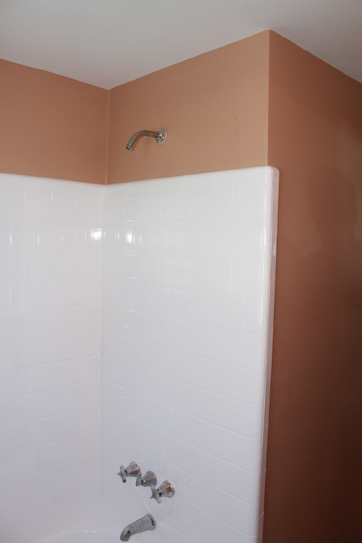 Clean white refinished tile in shower