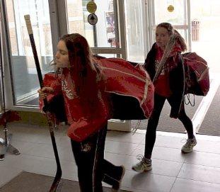 Girls carrying huge bags