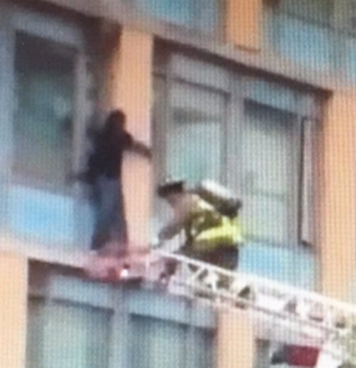 Woman rescued from ledge, charged with arson downtown