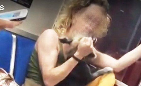 Woman seen grabbing, hitting, biting dog