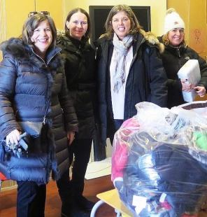 Marie Bates, principal of CGS, with staff delivering winter clothes