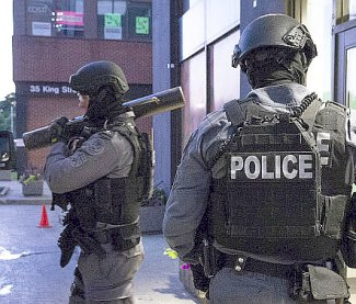 70 gang members charged in raids on gun and drugs activity
