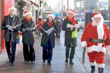 What better way to get into the festivities than with Santa and Christmas Carollers? Photo Bayview Leaside BIA