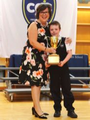 Principal Marie Bates congratulates the winner of The Joan Kennedy Cup for Academic Achievement
