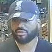 New photo of suspect wearing distinctive cap