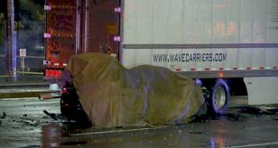 Vehicle that slammed into rear of tractor-trailer is covered with tarpaulin to hide carnage/CP24 capture