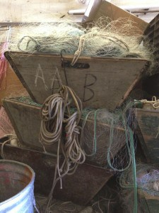 "These trapezoidal net boxes, (lower right) are marked ""A B"" for Anderson Brothers, the name of Alvin and his brothers' first fishing company.  —photo Katherine Keller"