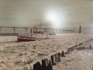 An old photo of Anderson's boat Aloha chugging back to shore through the ice at the Algoma, Wis. pier. —courtesy Alvin and Sandy Anderson