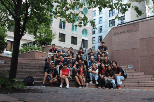The Proteges pose atop the steps of Boston College