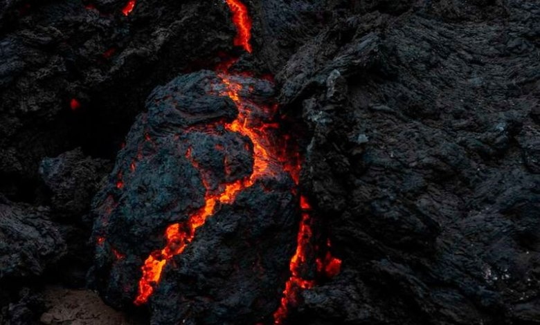 The smoldering lava from the Mount Nyiragongo eruption is seen in Goma on May 23, 2021.   Photo byMoses Sawasawa   AFP