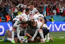 Harry Kane is mobbed by his team-mates after scoring England's winner