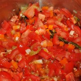 Now for the star of the show... lots of freshly chopped tomatoes...