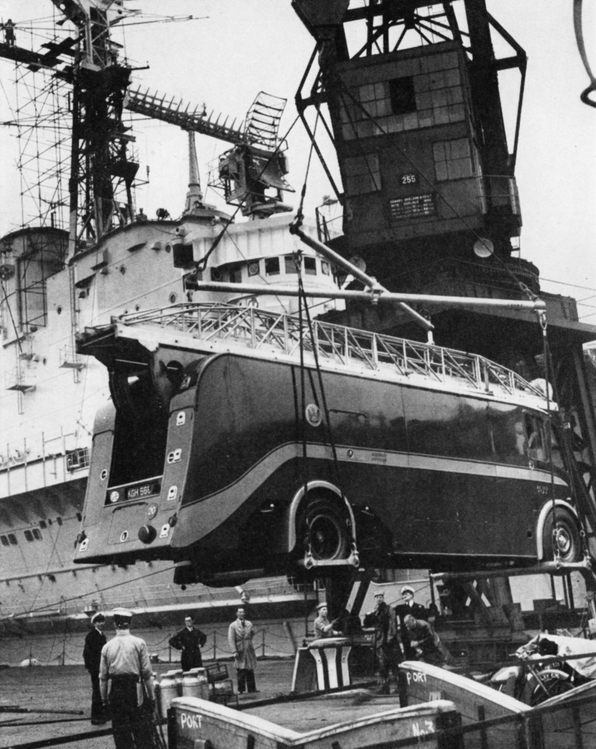 A BBC OB van is winched aboard a sailing ship