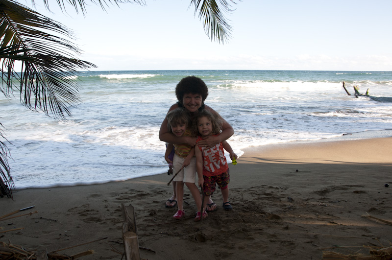 Eloise, Oliver, & Nana on the beach in front of our villa.