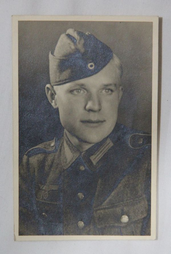 R009. WWII GERMAN REAL PICTURE POSTCARD OF A YOUNG WEHRMACHT SOLDIER