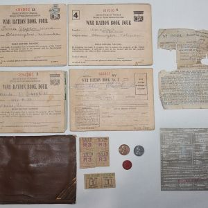I063. WWII RATION BOOK FOLDER WITH MANY CONTENTS