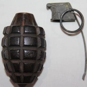 E279. INERT WWII MKII HAND GRENADE MODIFIED TO BE A DESK LIGHTER