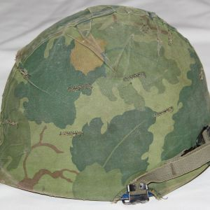 T050. NAMED VIETNAM USAF M1 HELMET WITH CAMOUFLAGE COVER