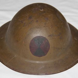 B248. WWI BRODIE HELMET WITH PAINTED 7TH INFANTRY DIVISION PATCH