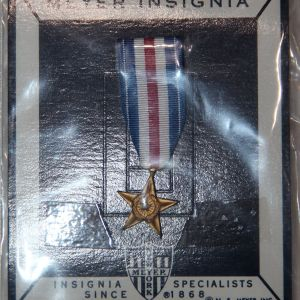 U013. MINIATURE SILVER STAR MEDAL BY NS MEYER