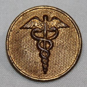 B131. POST WWI FIRST PATTERN GILT MEDICAL COLLAR DISK