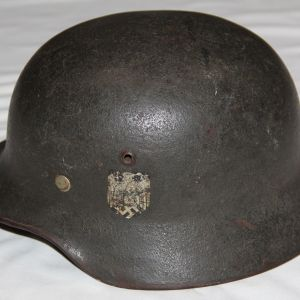 L033. WWII GERMAN REISSUE M35 SINGLE DECAL ARMY HELMET WITH COVERED NATIONAL SHIELD