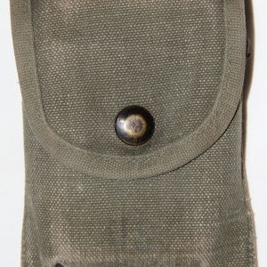 T102. PRE VIETNAM FIRST AID OR COMPASS POUCH WITH BANDAGE